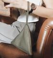 Black Miniature Chimaki bag Fabric bag with simple geometric design dimension: L 17(bottom) x H 14x D 14cm.  ชิมากิเป็นกระเป๋าถือทำจากผ้าได้รับ แรงบัลดาลใจมาจากทรงข้าวปั้นญี่ปุ่น ด้วยการออกแบบทรงฐานสามเหลี่ยมที่ค่อนข้างกว้างทำให้กระเป๋าเป็นทรงแข็งแรงวางตั้ง ได้ไม่ล้ม ผ้าเนื้อมันเงาอยู่ทรงแข็งแรง ถือง่ายใช้ได้ทั้งผู้หญิงและผู้ชาย  #CHAPIEEofficial #bag #กระเป๋าถือ #กระเป๋า #กระเป๋าใบเล็ก #กระเป๋าทรงสามเหลี่ยม
