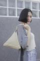 Chimaki bag Fabric bag with simple geometric design dimension: L 30(bottom) x H 28 x D 28 m.  ชิมากิเป็นกระเป๋าถือทำจากผ้าได้รับ แรงบัลดาลใจมาจากทรงข้าวปั้นญี่ปุ่น ด้วยการออกแบบทรงฐานสามเหลี่ยมที่ค่อนข้างกว้างทำให้กระเป๋าเป็นทรงแข็งแรงวางตั้ง ได้ไม่ล้ม ผ้าเนื้อมันเงาอยู่ทรงแข็งแรง ถือง่ายใช้ได้ทั้งผู้หญิงและผู้ชาย  มีจุดเด่นคือเป็นได้ทั้งกระเป๋าถือและกระเป๋าสะพาย ซึ่งสายคล้องสามารถเกี่ยวเก็บได้ไม่เกะกะ และยังสามารถปรับขนาดได้ด้วยเทคนิคเฉพาะที่ไม่เหมือนใคร ด้านในมีกระเป๋าเล็กๆสำหรับจัดระเบียบโทรศัพท์หรือของใช้จุกจิกให้เป็น สัดส่วน  สามารถถือใช้ได้ 3 แบบ  #CHAPIEEofficial #bag #กระเป๋าถือ #กระเป๋า #กระเป๋าทรงสามเหลี่ยม