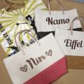 """:: กระเป๋าผ้า - NameBag by Lapindesigns ::  รายละเอียดสินค้า  + ขนาด : Width 14"""" x Height 10"""" x Depth 6"""" + โทนสี : กรม, ชมพู, เหลือง + ราคา : 750 บาท  . . . . . . . . . . . . . . . . . . . . . . . . . . . . . . . . . .  คำอธิบายสินค้า (Description)  กระเป๋าผ้า สองสี ปักชื่อ ลูกค้าสามารถเลือกสี เลือกลายปักได้ตามใจชอบนะคะ โดยสามารถระบุชื่อที่ลูกค้าต้องการปักไว้ที่ Note to seller หรือช่องข้อความเพิ่มเติมถึงร้านค้าได้เลยนะคะ  😜😃😊😄🙏🏻  . . . . . . . . . . . . . . . . . . . . . . . . . . . . . . . . . .  #tote #souvenirwedding #souvenirbag #souvenir #souvenirs #bag #bags #bag👜 #totebag #handbag #handbags #report #shoppingthailand #nametagbag #madetoorderbags #madetoorder #LapinDesigns"""