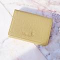 """กระเป๋าสตางค์หนังแท้ """"Mini Purse""""  สี : เหลือง (Custard Yellow) ผลิตจากหนังวัวแท้ ประเภทหนัง Floater มี Texture ที่มีลวดลายเป็นเอกลักษณ์  หนังแท้ใช้งานได้ยาวนาน  ผิวสัมผัส : กึ่งแข็งกึ่งนิ่ม Dimension : 11x 8.3 x 1.8 cm Weight : 46 grams  Product code : MP Price : 495 THB. - Made from genuine leather (cow leather) - Features coin section, 3 noted sections  and 2 card sections - Tab fastening  รายละเอียดสินค้า (TH) วัสดุ : ทำจากหนังแท้ Floater มีช่องทั้งหมด 6 ช่อง : ประกอบด้วย ช่องด้านใน 5 ช่อง และช่องด้านหลัง 1 ช่อง โดยช่องด้านในตรงกลางเหมาะสำหรับใส่แบงค์พับครึ่ง, เหรียญ , หรือบัตรได้หลายใบ"""