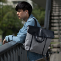 """ZINC - Fold&Hold (Textured Edition)""  Category: Backpack Materials: Canvas + Artificial Leather Size: 5""W x 15""L x 12""H Color: Navy Grey (สีกรม - สีเทา)  Compartments: + Outer Pockets: 1 Big Pocket at The Back + Inner Pockets: 1 Normal Pocket, 1  Laptop Pocket, 2 Small Pockets  Capacity: + Mobile Phone + Wallet + Small Umbrella + Laptop with maximum size 13"" + Ipad + Books / Notebooks + Cosmetics + Stationary  HANDMADE IN BKK, THAILAND * Please note that due to lighting effect and computer color, the actual color might be slightly different from the picture.*  #แคนวาส #กระเป๋า #กระเป๋าเป้ #กระเป๋าผ้า #สีเทา #zinc #zincbag"