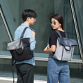 """ZINC - Fold&Hold""  Category: Backpack Materials: Canvas + Artificial Leather Size: 5""W x 15""L x 12""H Color: Navy - Grey (สีกรม - สีเทา)  Compartments: + Outer Pockets: 1 Big Pocket at The Back + Inner Pockets: 1 Normal Pocket, 1  Laptop Pocket, 2 Small Pockets  Capacity: + Mobile Phone + Wallet + Small Umbrella + Laptop with maximum size 13"" + Ipad + Books / Notebooks + Cosmetics + Stationary  HANDMADE IN BKK, THAILAND * Please note that due to lighting effect and computer color, the actual color might be slightly different from the picture.*  #แคนวาส #กระเป๋า #กระเป๋าเป้ #กระเป๋าผ้า #ีสีเทา #zinc #zincbag"
