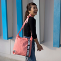 """""""ZINC - Definition""""  Category: Crossbody & Tote Bag Materials: Cotton Size: 2""""W x 13""""L x 14""""H Colors: ชมพู Pink  Compartments: + Inner Pockets: 1 Normal Pocket, 1 Zip Pocket  Capacity: + Mobile Phone + Power Bank + Ipad / Tablets + Wallet + Small Umbrella + Books + Cosmetics + Stationary  HANDMADE IN BKK, THAILAND * Please note that due to lighting effect and computer color, the actual colors might be slightly different from the picture.*  #กระเป๋า #กระเป๋าผ้า #กระเป๋าสะพาย"""