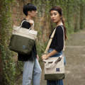 """""""ZINC - Transformize M""""  Category: Crossbody Bag & Handbag Materials: Canvas Size: 4""""W x 13""""L x 15.5""""H Color: Light Brown - Olive (สี น้ำตาลอ่อน - สี เขียวขี้ม้า )  Compartments: + Outer Pockets: 2 Pockets at the front + Inner Pockets: 1 Normal Pocket, 1 Zip Pocket, 2 Small Pockets  Capacity: + Mobile Phone + Power Bank + Ipad / Tablets + Wallet + Small Umbrella + Books + Cosmetics + Stationary + A4 Paper  HANDMADE IN BKK, THAILAND * Please note that due to lighting effect and computer color, the actual color might be slightly different from the picture.*  #แคนวาส #กระเป๋า #กระเป๋าผ้า #กระเป๋าสะพาย #สีเขียวขี้ม้า #zinc #zincbag"""
