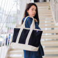 """""""ZINC - Cotton Street""""  Category: Tote Bag Materials: Canvas, Cotton Size: 8""""W x 22""""L x 13""""H Colors: ดำ - ขาว Black-White   Compartmets: + Inner Pockets: 1 Normal Pocket, 2 Small Pockets, 1 Small Zip Pocket  Capacity: + Mobile Phone + Wallet + Small Umbrella + Ipad + Books / Notebooks + Cosmetics + Stationary  HANDMADE IN BKK, THAILAND * Please note that due to lighting effect and computer color, the actual colors might be slightly different from the picture.*  #กระเป๋า #กระเป๋าผ้า #กระเป๋าสะพาย"""
