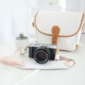 Handmade camera strap made from natural colour genuine cowhide Smooth & sweet White lambskin neck pad  สายคล้องกล้อง แฮนด์เมด ตัวสายทำจากหนังคาวน์ไฮด์มีความแข็งแรงสามารถรองรับน้ำหนักของกล้องได้เป็นอย่างดี และ บริเวณที่รองบ่าทำจากหนังแกะ เมื่อสัมผัสกับบริเวณคอหรือบ่าแล้วจะรู้สึกสบายและไม่เจ็บ เนื่องจากผิวของหนังแกะจะมีความนุ่มกว่าหนังอื่น ๆ ค่ะ  Material : 2.5mm Cowhide leather & lambskin neck pad Size : 133-143 cm. (สามารถปรับขนาดได้อีกเล็กน้อยค่ะ ) Colour : ขาว White Price : 1390 THB ( +shipping fee 60 THB )