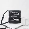 Size : W20 * H21 cm. Shoulder strap : 135 cm.  Made of : PU&PVC Color : ดำ Black Detail : กระเป๋า 2 ช่อง เปิด-ปิดด้วยซิป 1 เส้น ฝากระเป๋า เปิด-ปิดด้วยแม่เหล็ก 1 ตัว / 1 ช่องกระเป๋าด้านหลัง / 1 ช่องซิปเล็กด้านในกระเป๋า / มีซิปขยายด้านข้างได้ / ซับในสีดำ / อะไหล่สีเงิน