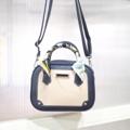 Size : W21 * H15 * D6 cm. Shoulder strap : 140 cm.  Made of : PU&PVC Color : กรม Navy blue Detail : 1 ช่องใหญ่เปิด-ปิด ด้วยซิป / 1ช่องซิปเล็กด้านในกระเป๋า / ซับในสีดำ  *** FREE ริบบิ้น 1ผืน *สีของริบบิ้นถูกเลือกมาพร้อมกระเป๋าแล้ว*  #กระเป๋า #กระเป๋าสะพาย #กระเป๋าผู้หญิง #กระเป๋าถือ