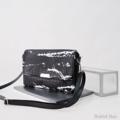 กระเป๋าขนาดกะทัดรัด ถือแบบกระเป๋าคลัทช์หรือสะพายก็ดูเท่ห์   Size : W27 * H18 cm. Shoulder strap : 135 cm.  Made of : PU&PVC Color : ดำ Black Detail : กระเป๋า 3 ช่อง เปิด-ปิดด้วยซิป 1 เส้น ฝากระเป๋า เปิด-ปิดด้วยแม่เหล็ก 2 ตัว / 1 ช่องซิปด้านหลังกระเป๋า / 1 ช่องซิปเล็กด้านในกระเป๋า / ซับในสีดำ / อะไหล่สีเงิน  #กระเป๋า #กระเป๋าสะพาย #กระเป๋าผู้หญิง #กระเป๋าถือ