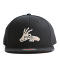 """This Snapback cap features an embroidered FINGER at front, a stitched flipper at wearer's back side. Interior includes printed taping and a moisture absorbing sweatband. The six panel construction features breathable eyelets with a flatted  visor and button at top. Open back has an adjustable snapback.   - Style: Flat visor snapback cap - Material: Made of Acrylic wool - Color: Black - Size: 56.5~58.5 cm Adult free (Snap adjustable) - Feature: Flipper embroidered FINGER snapback - Country of manufacture: Made in VIETNAM - Have a closure behind to increase/decrease size.  Notes: Due to the light and screen setting difference, the item's color may be slightly different from the pictures. Please allow slight dimension difference due to different manual measurement."""