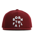 """This Snapback cap features a 3D embroidered """"Born To Fail"""" letter at front, a stitched flipper at wearer's back side. Interior includes printed taping and a moisture absorbing sweatband. The six panel construction features breathable eyelets with a flatted  visor and button at top. Open back has an adjustable snapback.   - Style: Flat visor snapback cap - Material: Made of Acrylic wool - Color: Wine - Size: 56.5~58.5 cm Adult free (Snap adjustable) - Feature: Flipper BornToFail snapback - Country of manufacture: Made in VIETNAM - Have a closure behind to increase/decrease size.  Notes: Due to the light and screen setting difference, the item's color may be slightly different from the pictures. Please allow slight dimension difference due to different manual measurement."""