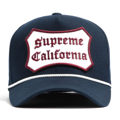 """This D Frame cap with plastic snap behind features a embroidered """"SUPREME CALIFORNIA"""" patch at front and 3D rubber """"CHRISTOPHER"""" at wearer's back side. Interior includes printed taping and a moisture absorbing sweatband. The fine panel construction features breathable eyelets with a curved visor; twisted rope between crown and visor; and button at top. Open back has an adjustable snapback.   - Style: Curved visor baseball cap - Material: Made of 100% COTTON - Color: Navy - Size: 56.5~58.5 cm Adult free (Snap adjustable) - Feature: NONAME California Patch cap, D TYPE - Country of manufacture: Made in VIETNAM - Have a closure behind to increase/decrease size.  Notes: Due to the light and screen setting difference, the item's color may be slightly different from the pictures. Please allow slight dimension difference due to different manual measurement."""