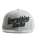 """This Snapback cap features a 3D embroidered EVERYTHING*UCKS letter at front, a stitched flipper at wearer's back side. Interior includes printed taping and a moisture absorbing sweatband. The six panel construction features breathable eyelets with a flatted  visor and button at top. Open back has an adjustable snapback.   - Style: Flat visor snapback cap - Material: Made of Acrylic wool - Color: Grey - Size: 56.5~58.5 cm Adult free (Snap adjustable) - Feature: Flipper 3D embroidered EVERYTHING*UCKS snapback - Country of manufacture: Made in VIETNAM - Have a closure behind to increase/decrease size.  Notes: Due to the light and screen setting difference, the item's color may be slightly different from the pictures. Please allow slight dimension difference due to different manual measurement."""