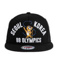 """This Snapback cap features with an embroidered tiger and """"SEOUL KOREA"""" letter at front. Interior includes printed taping and a moisture absorbing sweatband. The five panel construction features breathable eyelets with a flatted visor and button at top. Open back has an adjustable snapback.   - Style: Flatted visor snapback - Material: Made of 100% Cotton - Color: Black - Size: 56.5~58.5 cm Adult free (Snap adjustable) - Feature: PREMIER Olympic Tiger snapback. - Country of manufacture: Made in VIETNAM - Have a closure behind to increase/decrease size.  Notes: Due to the light and screen setting difference, the item's color may be slightly different from the pictures. Please allow slight dimension difference due to different manual measurement."""
