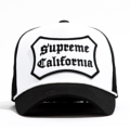 """This D Frame cap with plastic snap behind features a embroidered """"SUPREME CALIFORNIA"""" patch at front and 3D rubber """"CHRISTOPHER"""" at wearer's back side. Interior includes printed taping and a moisture absorbing sweatband. The fine panel construction features breathable eyelets with a curved visor; twisted rope between crown and visor; and button at top. Open back has an adjustable snapback.   - Style: Curved visor baseball cap - Material: Made of 100% COTTON - Color: White
