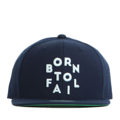 """This Snapback cap features a 3D embroidered """"Born To Fail"""" letter at front, a stitched flipper at wearer's back side. Interior includes printed taping and a moisture absorbing sweatband. The six panel construction features breathable eyelets with a flatted  visor and button at top. Open back has an adjustable snapback.   - Style: Flat visor snapback cap - Material: Made of Acrylic wool - Color: Navy - Size: 56.5~58.5 cm Adult free (Snap adjustable) - Feature: Flipper BornToFail snapback - Country of manufacture: Made in VIETNAM - Have a closure behind to increase/decrease size.  Notes: Due to the light and screen setting difference, the item's color may be slightly different from the pictures. Please allow slight dimension difference due to different manual measurement."""