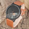 นาฬิกาข้อมือ Half Forest (Brown) Quartz Watch คุณภาพสูง 100%  ตัวเรือน : สแตนเลส วัสดุ : หนัง สีดำ ประเภทเข็ม : Pin Buckle  เส้นผ่าศูนย์กลาง : 4.0 ซม ความกว้างสาย : 2.0 ซม ความยาวสาย : ประมาณ 23.0 ซม  Free! - กล่องเก็บนาฬิกา - ส่งพัสดุฟรี ไม่เสียค่าส่ง