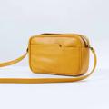 Size : W26 * H17 * D8 cm. Shoulder strap : 125 cm. Material : Premium PU leather Color : เหลือง มัสตาร์ด Mustard Detail : 2 ช่องใหญ่ เปิด-ปิดด้วยซิป / 1 ช่องด้านหน้ากระเป๋า / อะไหล่สีดำ  #กระเป๋า #กระเป๋าสะพาย #กระเป๋าผู้หญิง #กระเป๋าหนัง