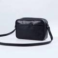 Size : W26 * H17 * D8 cm. Shoulder strap : 125 cm. Material : Premium PU leather Color : ดำ Black Detail : 2 ช่องใหญ่ เปิด-ปิดด้วยซิป / 1 ช่องด้านหน้ากระเป๋า / อะไหล่สีดำ  #กระเป๋า #กระเป๋าสะพาย #กระเป๋าผู้หญิง #กระเป๋าหนัง