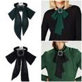 สร้อยคอ Bowknot Necklace Collar ผลิตจากวัสดุแถบริบบิ้นกำมะหยี่สีดำแต่งด้วยจี้โบว์ผ้าชีฟองอันใหญ่และกลัดด้วยหัวเข็มขัดอัลลอยด์เพื่อเพิ่มความโดดเด่น จากแบรนด์ Dbag by Mirror Dress ง่ายด้วยการแมชให้เข้ากับหลากหลายชุด ทำให้เสื้อผ้าที่เรียบง่าย ดูสวยเด่นขึ้นมาทันที  - ผลิตจากโลหะอัลลอยและผ้ากำมะหยี่,ชีฟอง - ปิดด้วยตัวล็อคแบบก้ามปู - สามารถปรับระดับได้   ความยาวสร้อยกำมะหยี่ x การปรับระดับความยาวสร้อย One Size (32 ซม. x 10 ซม.)  ความยาวโบว์ริิ้น One Size (29 ซม.)  น้ำหนัก 28 กรัม