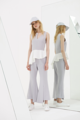 CHELSEA pants: high-waisted flared pants with asymmetrical hems and front slits. Fit: Normal Fit  Length: XS 36.5″, S 37″, M 37.5″