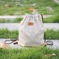 กระเป๋าผ้าแคนวาสลินิน สายเชือก มีซับกระเป๋าด้านใน Colur : กรม/เทา Size : 14*16 inch Price : 280.- Line : paelur
